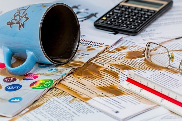 Picture of coffee spilled over papers on desk