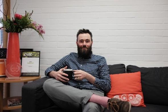 Head of Organic Search Jonathan Falgate sitting on sofa