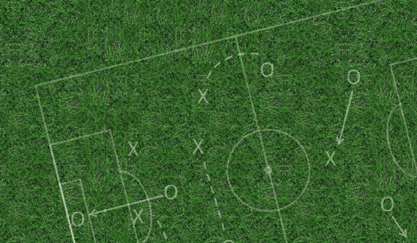 Football pitch image to illustrate the difference between strategy and planning