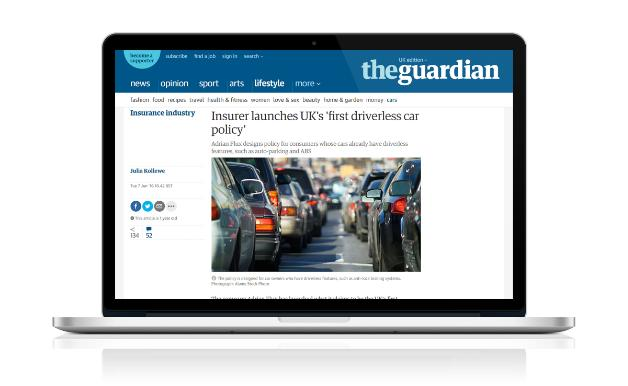 A laptop displaying an article placed on The Guardian's website.