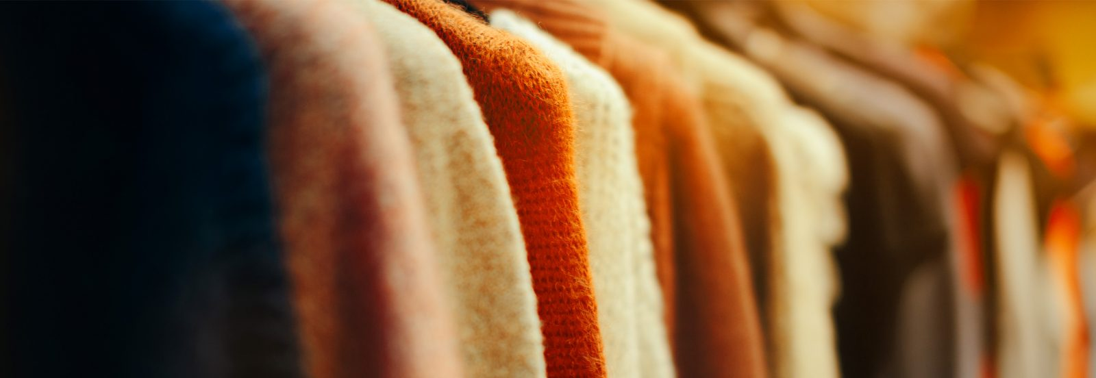 Close-up of clothing in a wardrobe.
